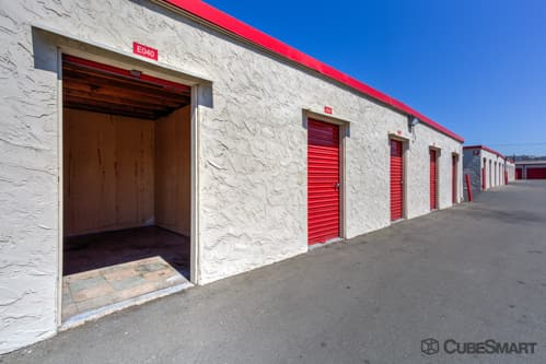Self storage units with red roll-up doors in Spring Valley, CA
