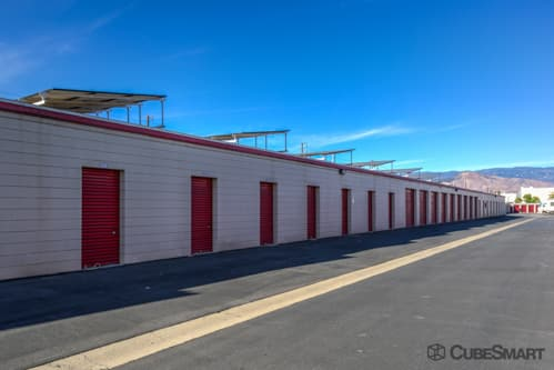 Self storage units with red roll-up doors in San Bernardino, CA