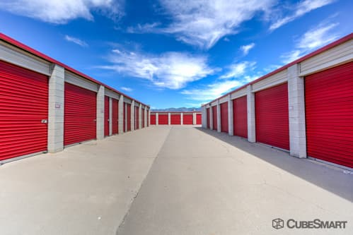 Self storage units with red roll-up doors in Rialto, CA