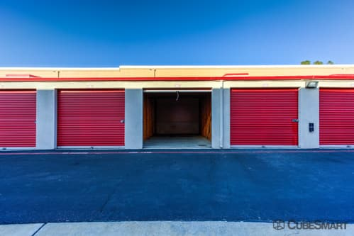 Self storage units with red roll-up doors in Vista, CA