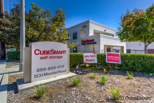 Exterior of a multi-story CubeSmart Self Storage facility in Escondido, CA