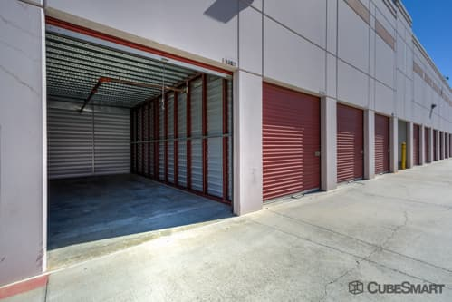 Self storage units with red roll-up doors in Escondido, CA