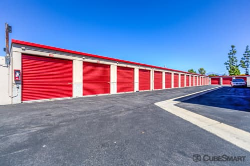 Self storage units with red roll-up doors in Walnut, CA