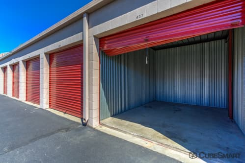 Self storage units with red roll-up doors in Ontario, CA