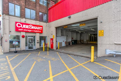 Exterior of a multi-story CubeSmart Self Storage facility in Brockton, MA