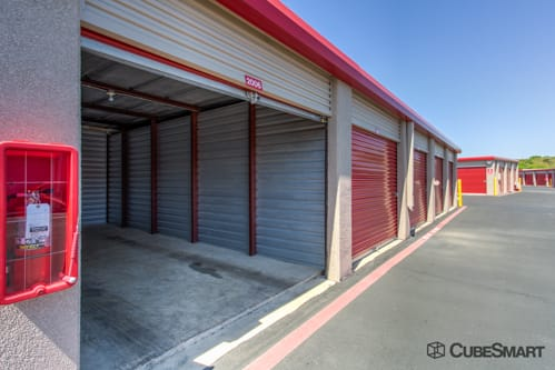Self storage units with red roll-up doors in San Antonio, TX