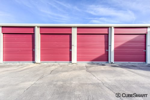 Self storage units with red roll-up doors in Reserve, LA