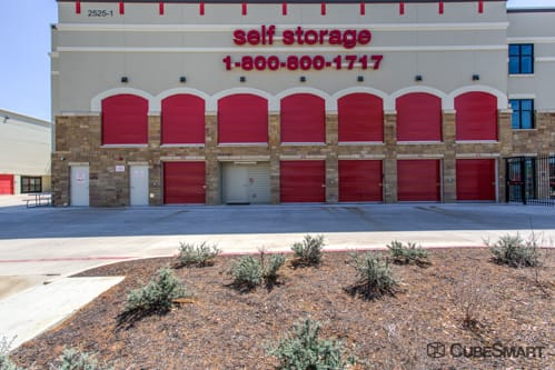 Self storage units with red roll-up doors in Austin, TX